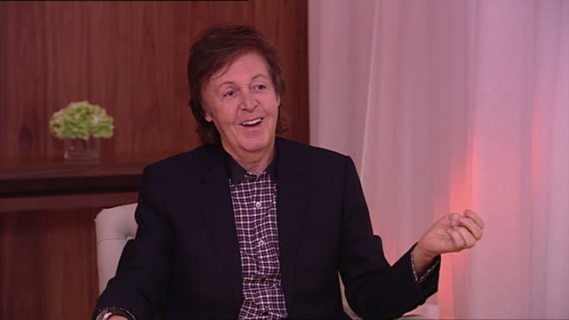 interior shot sir paul mccartney, former member of the beatles, talks about his job as a coil winder massey and coggins. he says john lennon and... - paul mccartney stock videos & royalty-free footage
