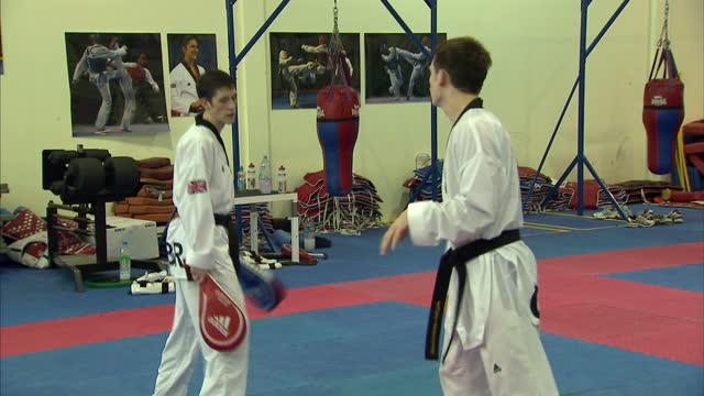 interior shots aaron cook & sarah stevenson training at the great britain olympic taekwondo academy in manchester. aaron cook & sarah stevenson -... - taekwondo stock videos & royalty-free footage