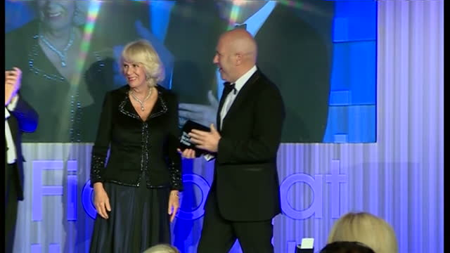 interior shots ac grayling announcing the winner of the 2014 man booker prize and camilla duchess of cornwall presents richard flanagan with award on... - booker prize stock-videos und b-roll-filmmaterial