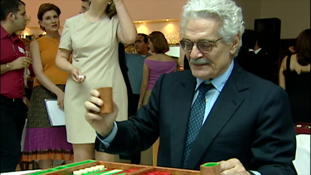 Interior shots actor Omar Sharif playing game of Backgammon at charity tournament on July 1st 2001 in London England