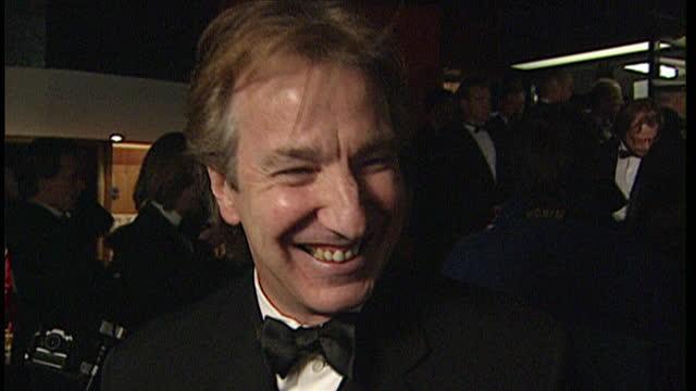 interior shots alan rickman walks into cinema, medium close up alan rickman smiling posing for press-op / interior interview alan rickman, actor /... - アラン・リックマン点の映像素材/bロール