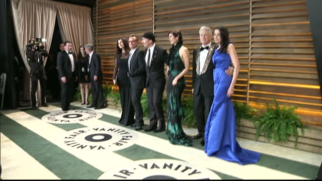Interior shots Ali Hewson Bono The Edge Morleigh Steinberg Adam Clayton and Mariana Teixeira De Carvalho on red carpet on March 02 2014 in Los...