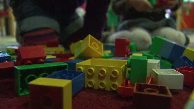 interior shots anonymous children playing with lego bricks in nursery nursery school children on january 24 2013 in london england - anonymous stock videos and b-roll footage