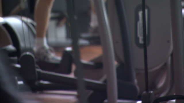 interior shots anonymous gym users working out on cross trainer on may 15 2014 in london england - cross trainer stock videos & royalty-free footage