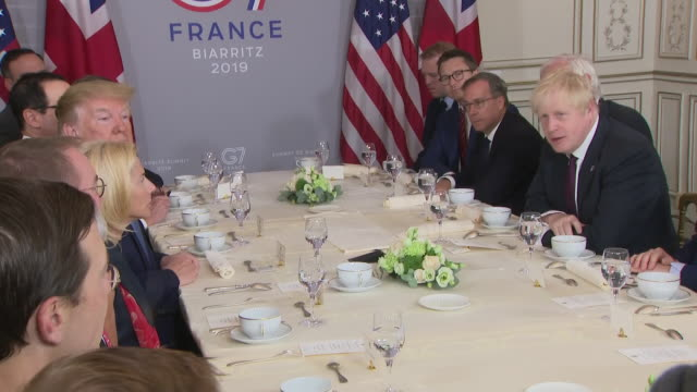 interior shots around table of british prime minister boris johnson talking to us president donald trump about brexit on 25 august 2019 in biarritz... - g7サミット点の映像素材/bロール