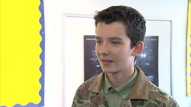 interior shots asa butterfield actor talks about how odd it is to be talking to the students instead of being a student the cast of ender's game... - game of chance stock videos & royalty-free footage