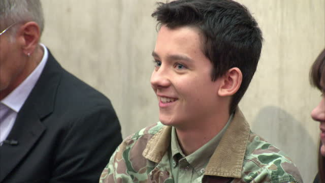 interior shots asa butterfield is introduced to the audience at a qa session at westminster academy the cast of ender's game visited the secondary... - game of chance stock videos & royalty-free footage