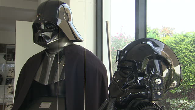 interior shots authentic darth vader outfit on display at shepperton design studios made with the same moulds used to produce outfits for the 1977... - shepperton studios stock videos & royalty-free footage