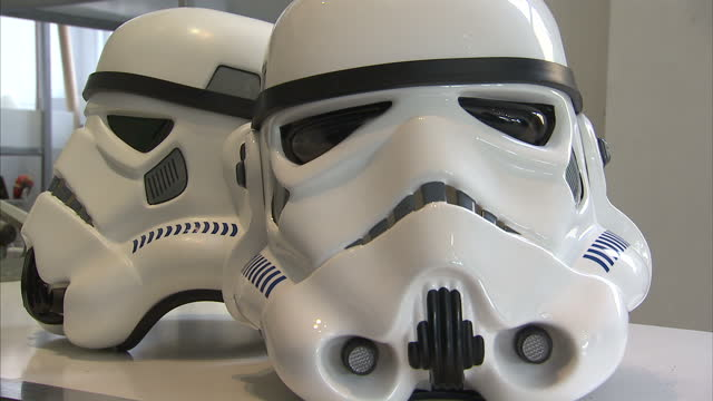 interior shots authentic stormtrooper and darth vader masks on display at shepperton design studios who produced the original stormtrooper outfits... - shepperton studios stock videos & royalty-free footage