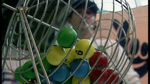 interior shots, ball cage is spun to choose lottery balls at pre-launch event on june 6, 1994 in london, england. - lotterie stock-videos und b-roll-filmmaterial