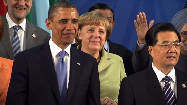 Interior shots Barack Obama Angela Merkel Julia Gillard Hu Jintao David Cameron Juan Calderon stand posing for the media wave to the cameras World...