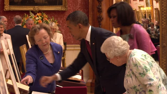 interior shots barack obama his wife michelle the queen prince philip tour room in buckingham palace inspecting some of the royal collection... - literature stock videos & royalty-free footage