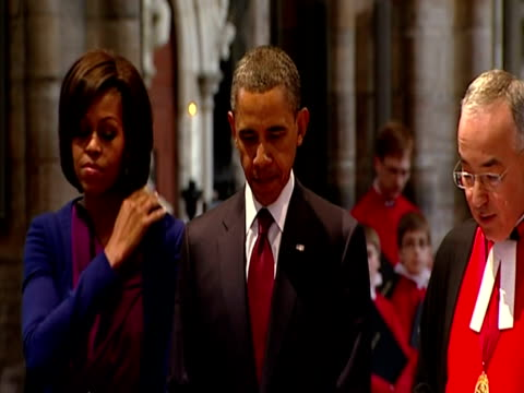 interior shots barack obama & his wife michelle walk over to the tomb of the unknown soldier & listen as prayers are read by dr john hall. interior... - tomb of the unknown warrior westminster abbey stock videos & royalty-free footage