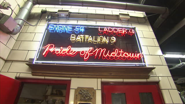 interior shots battalion 9 of the new york city fire department as firefighters leave the station in response to an emergency on july 20 2011 in new... - fire department of the city of new york stock-videos und b-roll-filmmaterial