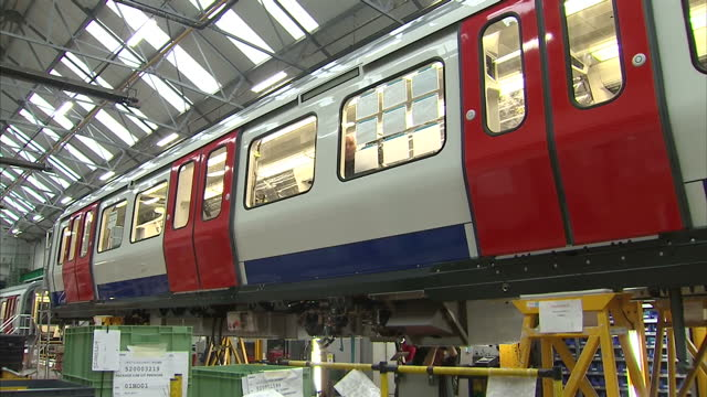 Interior shots Bombardier engineers working in production factory on new London Underground train carriages on in Derby England