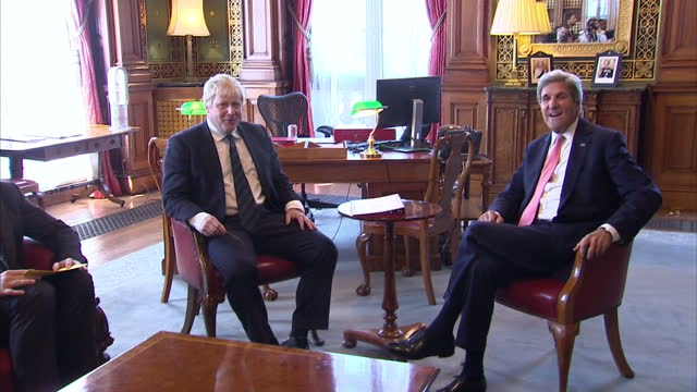 Interior Shots Boris Johnson Foreign Secretary sits with John Kerry US Secretary of State pose for snappers and joke with press