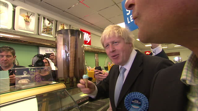 interior shots boris johnson mayor of london campaigning in ramsgate handing leaflets to people in restaurant boris johnson posing and eating with... - ramsgate stock videos & royalty-free footage