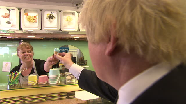vídeos de stock e filmes b-roll de interior shots boris johnson mayor of london travelling on train interior interview boris johnson exterior shots boris johnson campaigning in... - ramsgate