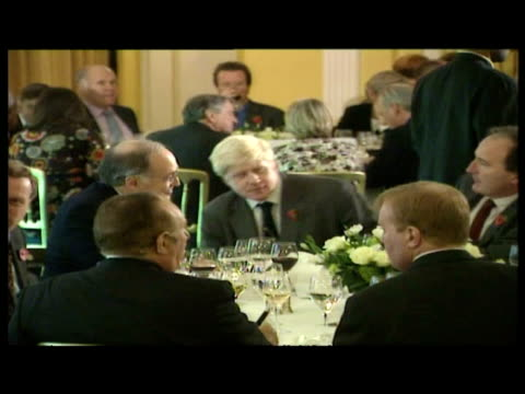 interior shots boris johnson takes seat talks with michael howard at conservative mps dinner - boris johnson stock videos & royalty-free footage