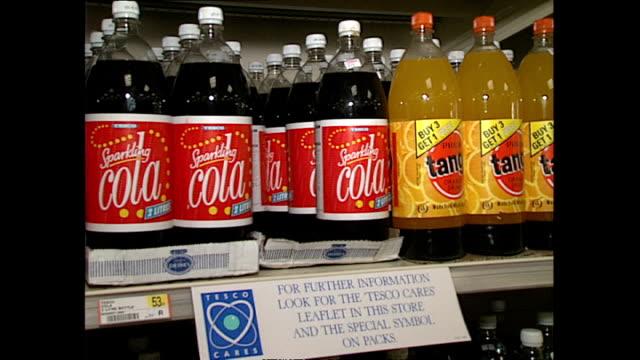 interior shots bottles of fizzy drink on shelves in tesco supermarket. . on january 13, 1989 in london, england. - fizzy lemonade stock videos & royalty-free footage