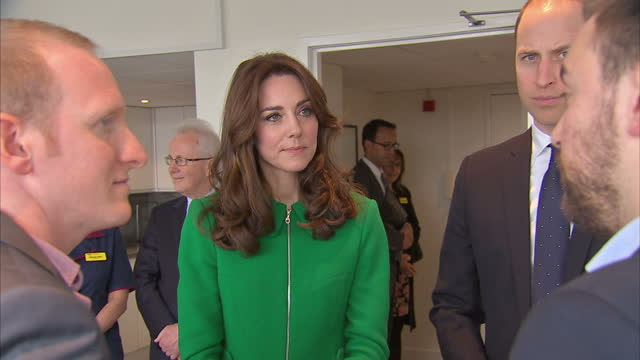Interior shots Britain's Catherine Duchess of Cambridge and Prince William Duke of Cambridge meeting with Jonny Benjamin and Neil Laybourn during...