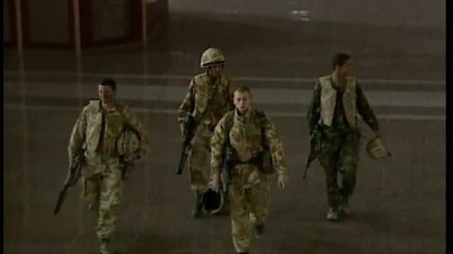 interior shots british soldiers walking around abandoned basrah international airport at the start of the 2003 invasion of iraq on march 27 2003 in... - bassora video stock e b–roll
