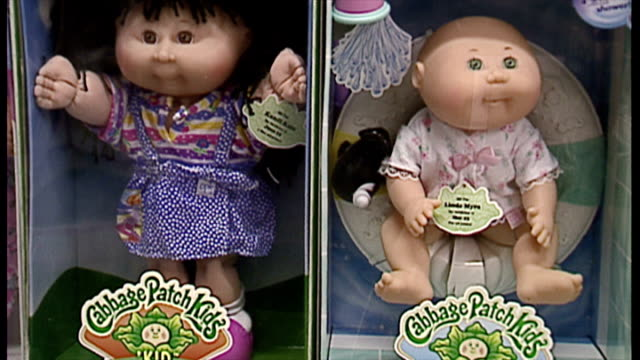 interior shots cabbage patch kids dolls in boxes on shelves in toy shop. on december 13, 1996 in london, england. - ドール点の映像素材/bロール