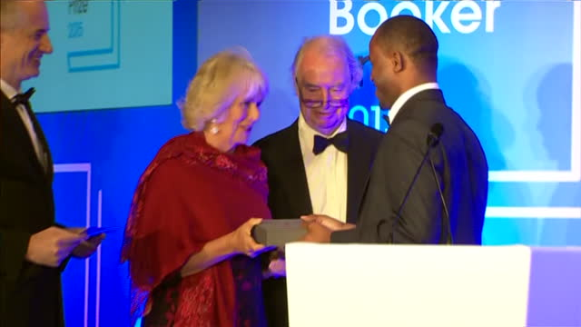 interior shots camilla duchess of cornwall presenting chigozie obioma author with award at the 2015 booker prize awards at guildhall london on... - booker prize stock-videos und b-roll-filmmaterial