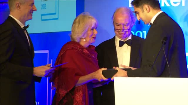 interior shots camilla duchess of cornwall presenting sunjeev sahota author with award at the 2015 booker prize awards at guildhall london on october... - booker prize stock-videos und b-roll-filmmaterial