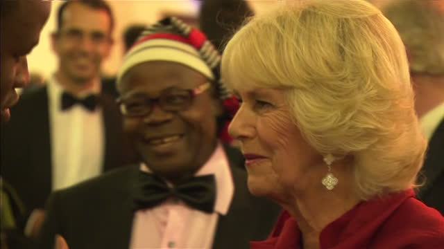 interior shots camilla duchess of cornwall talking with chigozie obioma author at 2015 booker prize award ceremony at guildhall london on october 13... - booker prize stock-videos und b-roll-filmmaterial