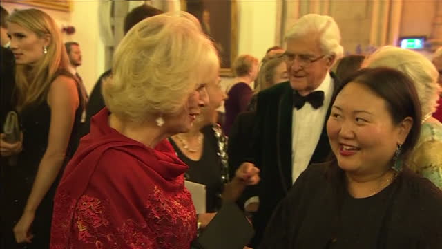 interior shots camilla duchess of cornwall talking with hanya yanagihara author at the 2015 booker prize award ceremony at guildhall london on... - booker prize stock-videos und b-roll-filmmaterial
