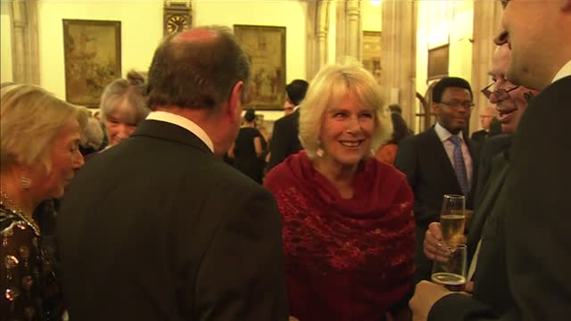 interior shots camilla duchess of cornwall talking with sunjeev sahota author other guests at 2015 booker prize award ceremony at guildhall london on... - booker prize stock-videos und b-roll-filmmaterial