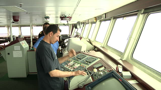 interior shots captain and staff of ferry in control room exterior shots of ferry deck and waves over side on april 23 2011 in az zawiyah libya - az zawiyah stock videos & royalty-free footage