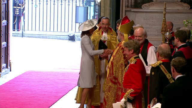 interior shots carole & james middleton greet clergy members & dignitaries inside before walking through the abbey sky news royal wedding westminster... - clergy stock videos & royalty-free footage