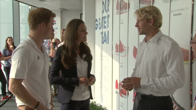 interior shots catherine duchess of cambridge prince harry chat with gold medal winning men's four rower andy triggs hodge at team gb house catherine... - canottaggio senza timoniere video stock e b–roll
