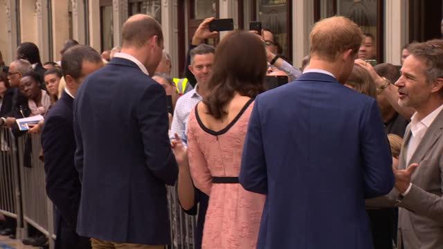 Interior shots Catherine Duchess of Cambridge Prince William Duke of Cambridge and Prince Harry walking with Paddington 2 film cast including Hugh...