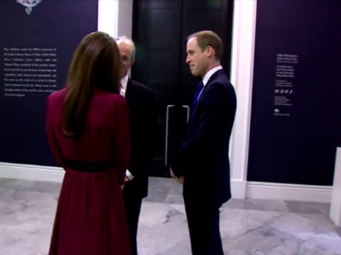 Interior shots Catherine Duchess of Cambridge Prince William walk into the National Portrait Gallery Catherine wears maroon outfit greet officials...