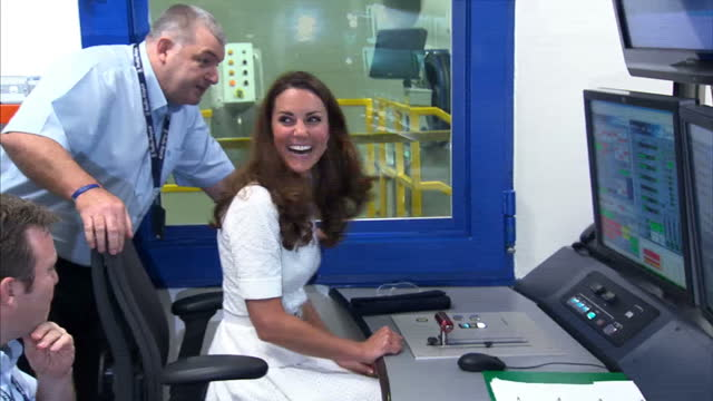 interior shots catherine, duchess of cambridge sits at jet engine wind control panel & operates throttle during a visit to the rolls royce factory in... - throttle stock videos & royalty-free footage