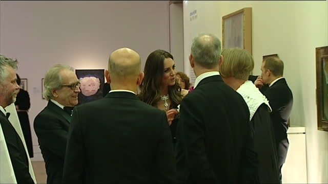 Interior shots Catherine Duchess of Cambridge talking with guests Director of the National Portrait Gallery Sandy Nairne and artist Grayson Perry at...