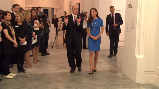 interior shots catherine duchess of cambridge tours the national portrait gallery wearing a blue short sleeved stella mccatney dress looking at a new... - short sleeved stock videos & royalty-free footage