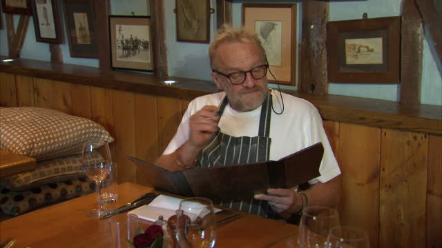 interior shots celebrity chef antony worrall thompson looking at menu, making notes at the grayhound freehouse on august 30, 2015 in london, england. - アントニー ウォラル トンプソン点の映像素材/bロール