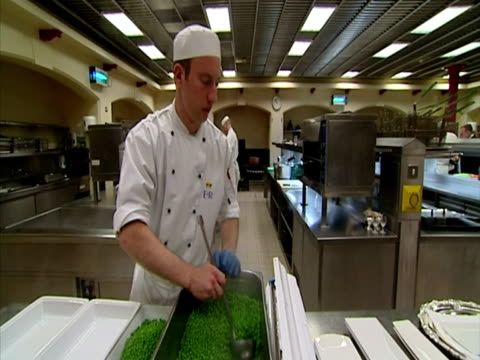 interior shots chefs working in the buckingham palace kitchens dishing up platters of peas sky news: royal wedding build-up footage on march 22, 2011... - britisches königshaus stock-videos und b-roll-filmmaterial