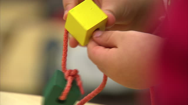 interior shots close of anonymous child playing with building blocks nursery school children on january 24, 2013 in london, england - school child stock videos & royalty-free footage