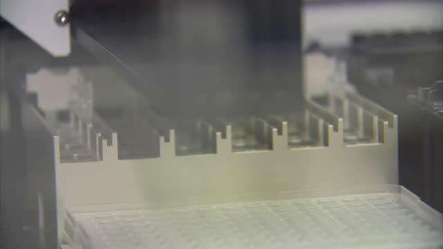interior shots close of automated pipette machine loading samples pipette machine in food control laboratory on february 15 2013 in cardiff - 馬肉点の映像素材/bロール