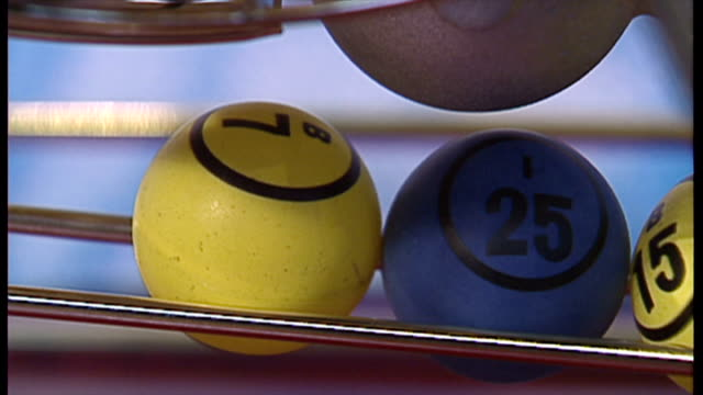stockvideo's en b-roll-footage met interior shots, close-ups of lottery balls lined up on november 19, 1994 in london, england. - loterijlootje