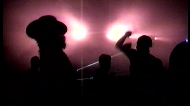 interior shots clubbers dancing and raving to club music at warehouse rave. . on march 09, 1990 in london, england. - crime stock videos & royalty-free footage