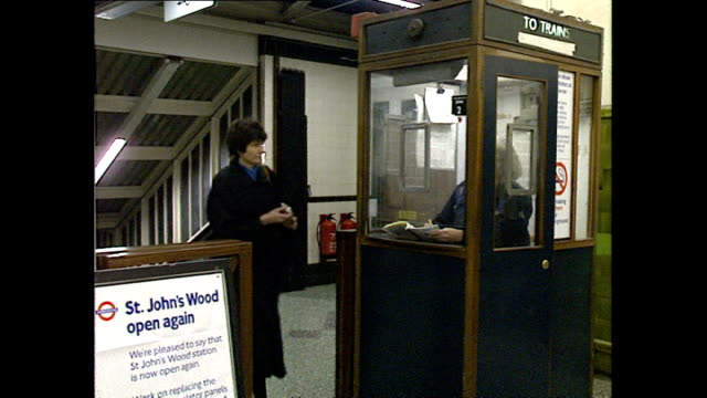 Interior shots commuters walking past manned ticket booth at Barons Court Underground station on April 19 1989 in London United Kingdom