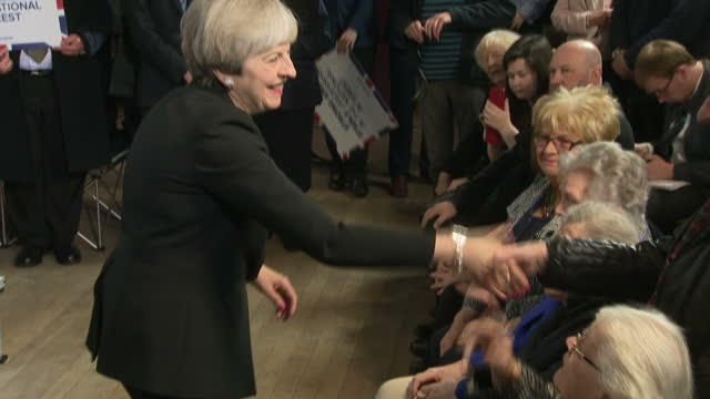 interior shots conservative prime minister theresa may shaking hands with supporters after giving speech at walmsley parish hall in bolton on 19th... - theresa may stock-videos und b-roll-filmmaterial