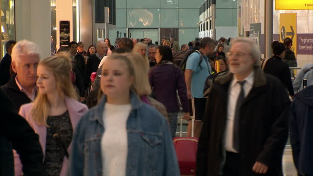 interior shots crowd of passengers in departure hall at heathrow airport on february 21 2015 in london england - flugpassagier stock-videos und b-roll-filmmaterial