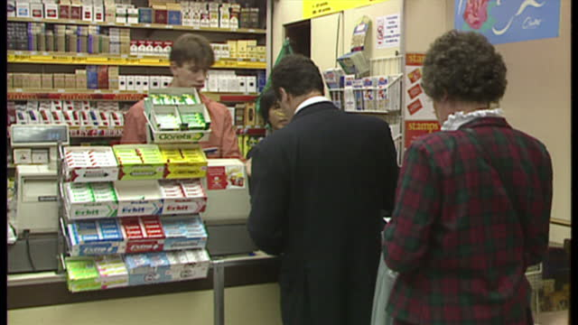 vídeos y material grabado en eventos de stock de interior shots customers buy national lottery tickets inside newsagents on november 18 1994 in london england - artículos de lotería